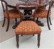Sale 9070H - Lot 82 - A set of four C19th mahogany dining chairs with scroll carving to back and rail and turned lappeted front legs and tufted upholstere...