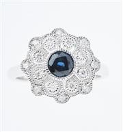 Sale 8402J - Lot 401 - AN 18CT WHITE GOLD SAPPHIRE AND DIAMOND CLUSTER RING; centring a round cut dark blue sapphire surrounded by 16 round brilliant cut d...