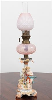 Sale 9070H - Lot 83 - A German porcelain kerosene lamp with pink reservoir and shade, Height 48cm