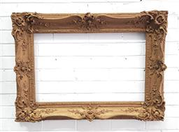 Sale 9126 - Lot 1097 - 19th Century Neo-Rococo Gilt Frame, the shaped moulded frame with articulated corners (73 x 100, opening 46 x 73 cm)
