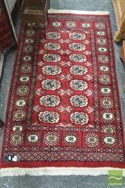 Sale 8310 - Lot 1601 - Small Turkoman Wool Carpet in Red Tones